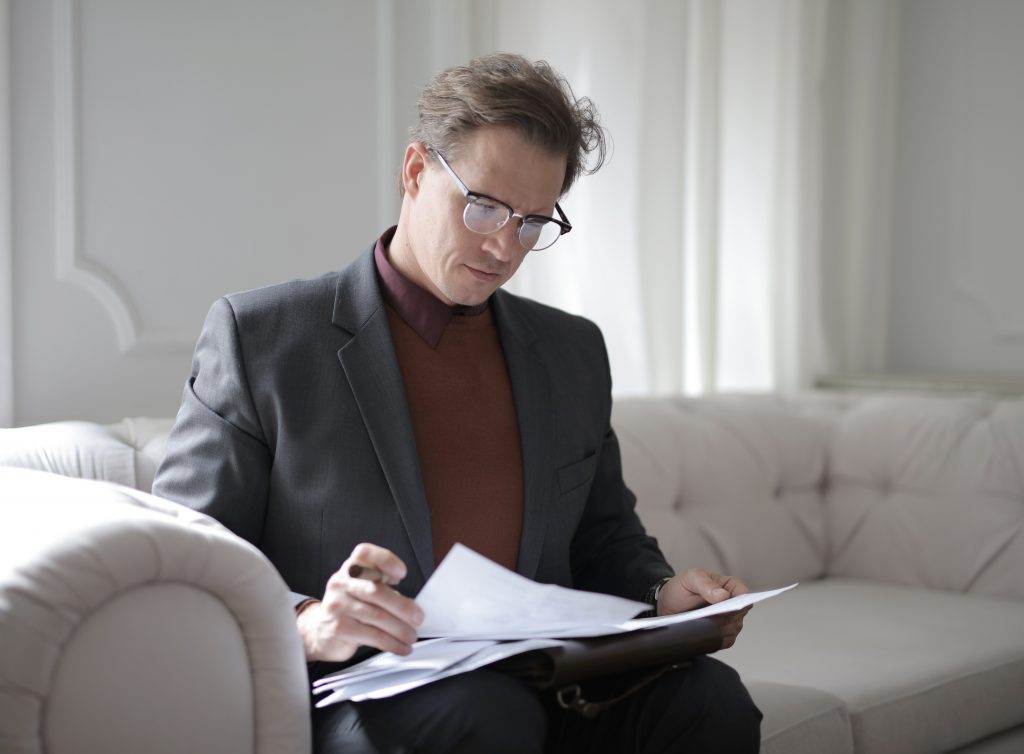criminal lawyer in Melbourne looking through some papers