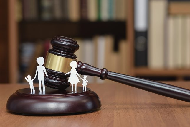 Gavel and a picture of a family. Sydney family law concept