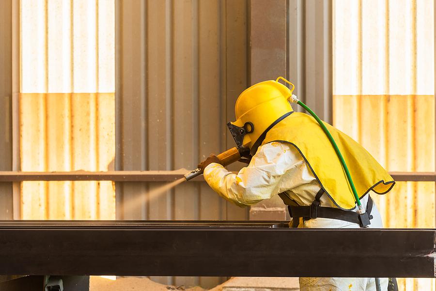 Industrial worker doing concrete sandblasting
